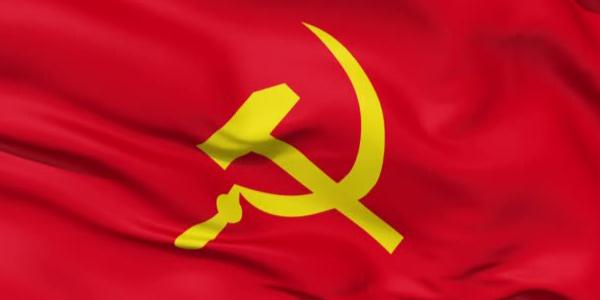 imagem da bandeira comunista, vermelha e com os símbolos do martelo e da foice